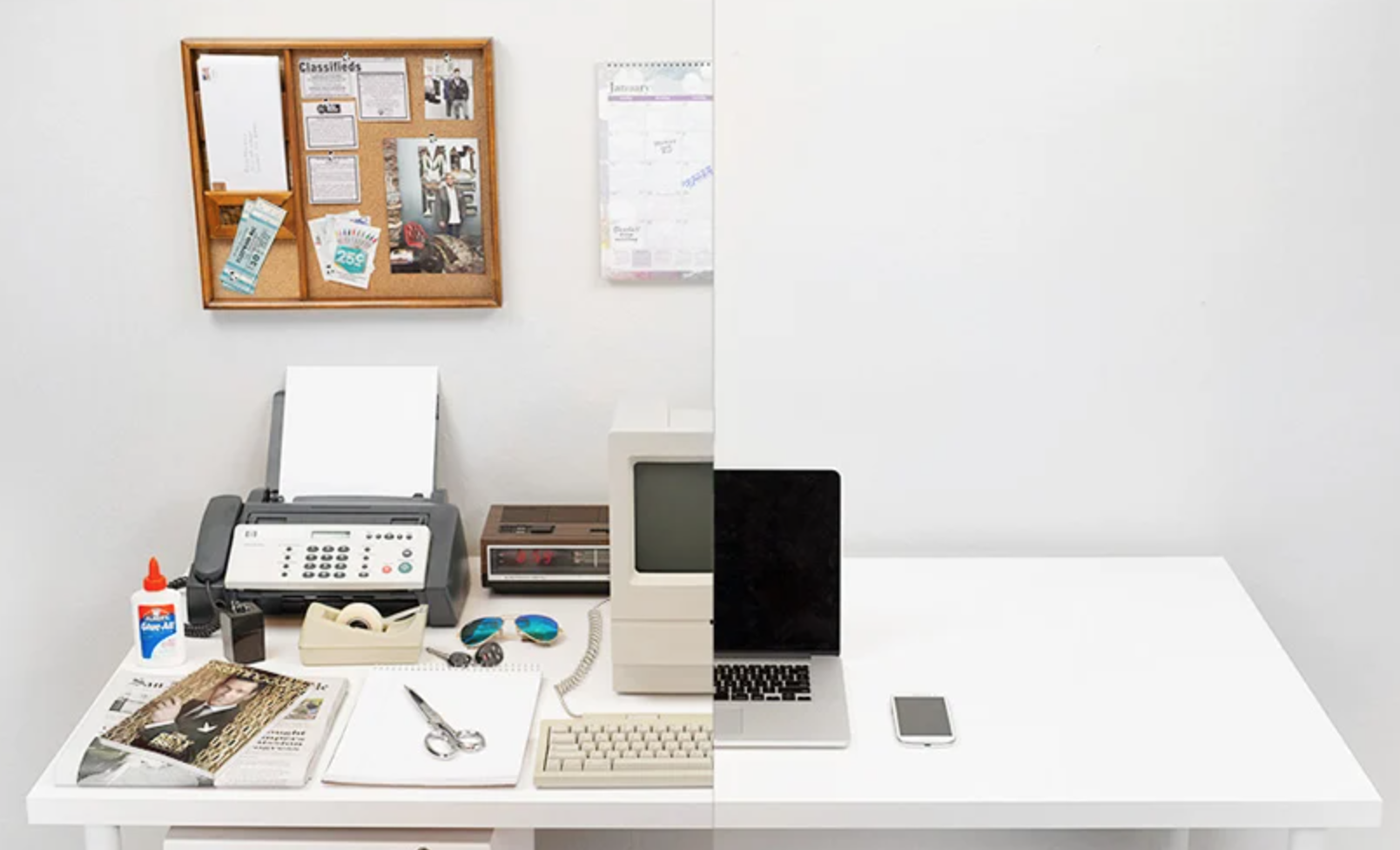 A split image - half shows a cluttered office desk of the past, the other a modern office desk with only a laptop and phone
